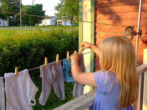 Kids and Chores Girl with Laundry