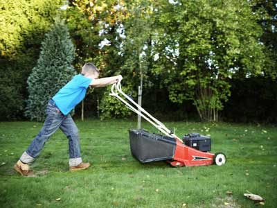 kids and chores boy mowing lawn