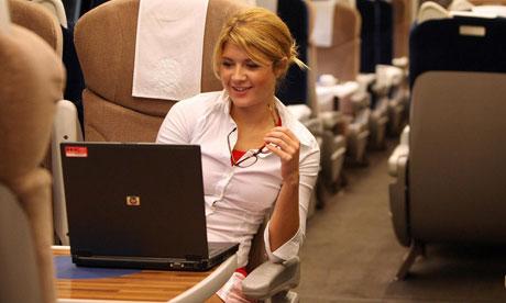 woman-uses-laptop-on-trai-007-1